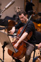 Cello player of the Galaxy Symphonic Orchestra tuning before the scoring of <em>Domino</em>