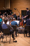 Recording Engineer Patrick Lemmens introducing composer Pino Donaggio to the orchestra
