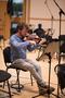 Violin player preparing for the recording