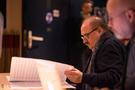 Composer Pino Donaggio looks over the score for Domino