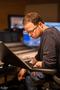 Recording Engineer Patrick Lemmens studies the score for Domino
