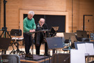Composer Pino Donaggio and conductor Natale Massara discussing the next session