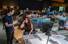 Showrunner Jared Stern talks with producer Helen Kalafatic during the scoring session