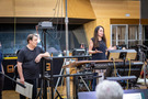 David Newman watches as producer Helen Kalafatic addresses the orchestra