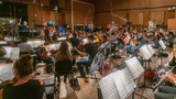 Composer/conductor Joseph Trapanese and the orchestra record a cue