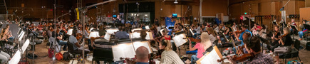 The orchestra records a cue for <i>Lady and the Tramp</i> with composer/conductor Joseph Trapanese