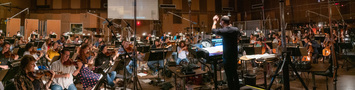 Composer/conductor Joseph Trapanese records a cue with the orchestra