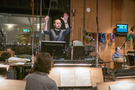 Composer Joseph Trapanese cues the orchestra