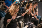 The flutes perform a cue