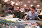 Scoring mixer Noah Snyder adjusts levels as composer Joseph Trapanese and orchestrator Jehan Stefan go over a cue