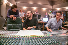 Composer Joseph Trapanese (center) talks with orchestrator Jehan Stefan (left) with scoring mixer Noah Snyder