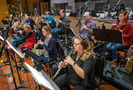 The woodwinds record a cue