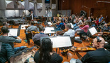 Conductor/lead orchestrator Tim Davies and the orchestra perform