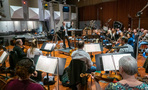 Conductor/lead orchestrator Tim Davies performs with the orchestra
