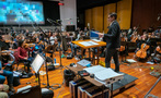 Conductor/lead orchestrator Tim Davies cues the violins