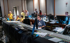 Composer Mark Mothersbaugh (left) talks with additional music composers Peter Seibert and Wataru Hokoyama as additional score mixer Tom Hardisty (center) and the music team prepare for the next cue