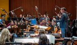 Conductor/lead orchestrator Tim Davies records a cue with the Hollywood Studio Symphony