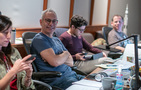 Supervising music editor Dominic Certo smiles for the camera with score mixing assistant Angelo Chacon and ProTools recordist Kevin Globerman