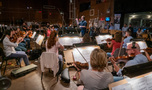 Composer/conductor Christopher Lennertz and the Hollywood Studio Symphony record a cue