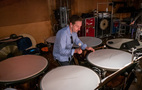 A percussionist performs on timpani