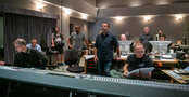 Composer Christopher Lennertz (center, right), director Tim Story (center, left), and the music team listen to the score for <i>Shaft</i>