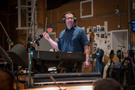 Composer/conductor Christopher Lennertz cues the orchestra