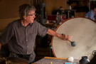 Percussionist Brian Kilgore performs on bass drum