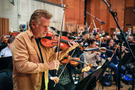 Concertmaster Bruce Dukov tunes with the orchestra