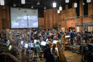 Composer/conductor Randy Newman records his score for <i>Toy Story 4</i> with the orchestra