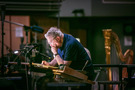 Composer Randy Newman makes edits to a cue at the podium