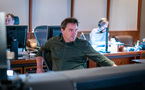 Scoring mixer Michael Perfitt listens to the orchestra perform