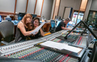 Orchestrator Amie Doherty makes edits to a cue with additional music composer Perrine Virgile while scoring mixer Michael Perfitt checks the mix