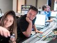 Scoring mixer Michael Perfitt and additional music composer Perrine Virgile look over a cue