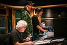 Score engineer Steve Bishir, producer Adam Anders, music producer Peer Åström, and arranger/programmer Martin Landström