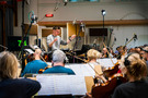 Erik Arvinder conducts the string section at Air Studios