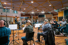 Erik Arvinder conducts the brass section at Air Studios