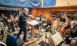 Orchestrator Pete Anthony conducts the string session