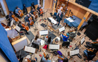 The strings record a cue with conductor / orchestra Pete Anthony