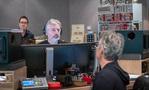 Score producer Buck Sanders talks with composer Marco Beltrami (front)