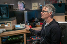 Composer Marco Beltrami listens to the playback