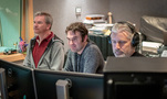 Additional music composer / orchestrator Marcus Trumpp, additional music composer Brandon Roberts, and score producer Buck Sanders listen to a cue